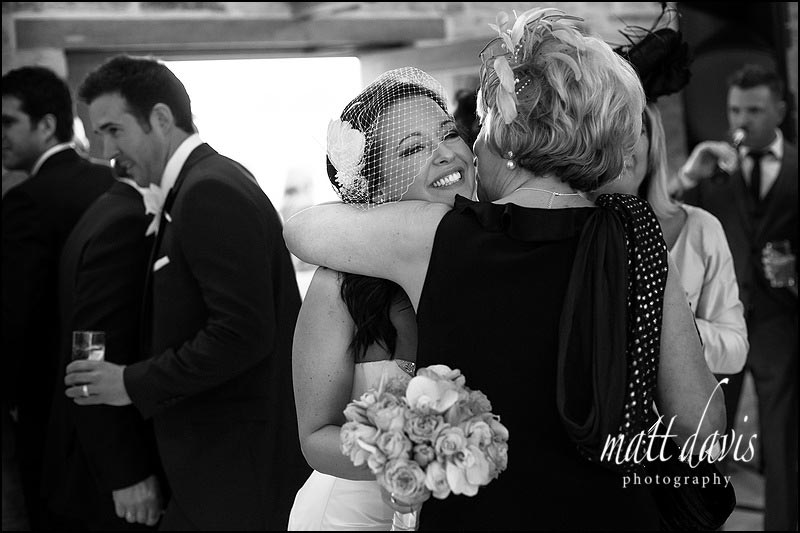 black and white photo of bride with Birdcage veil