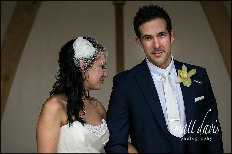 Birdcage vail with stylish photo of wedding couple at Kingscote Barn