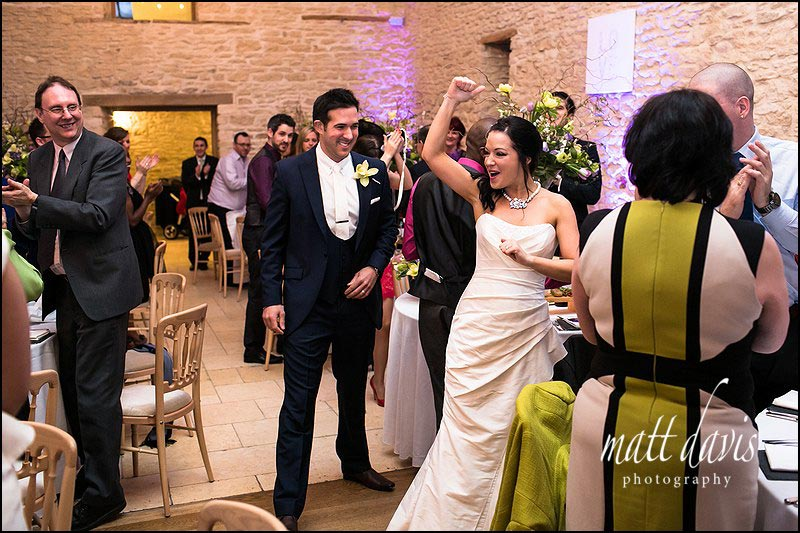 Bride enjoying a wedding at Kingscote Barn