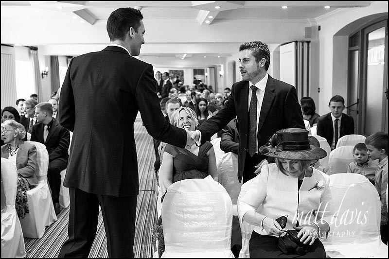Groom meeting guests before the wedding ceremony at Manor House Hotel