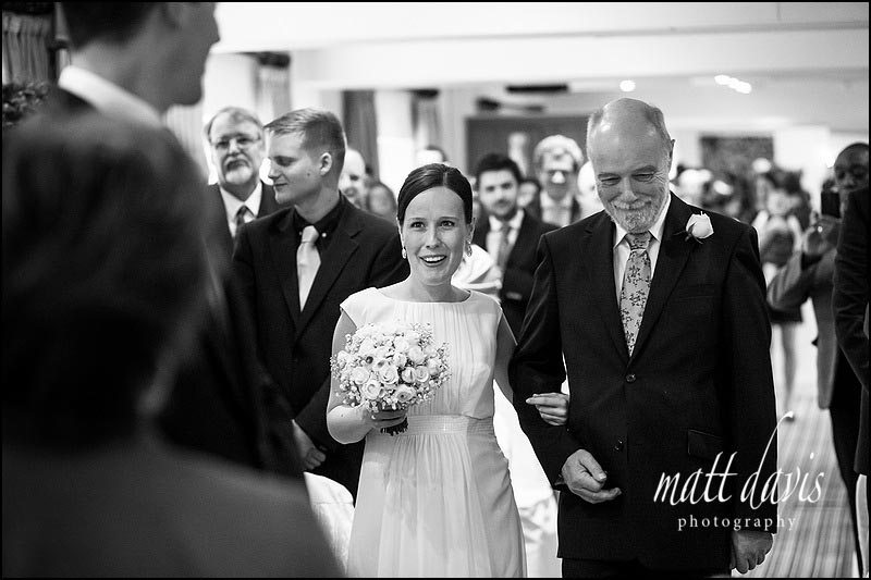 Bride walking down the aisle for wedding at Manor House Hotel