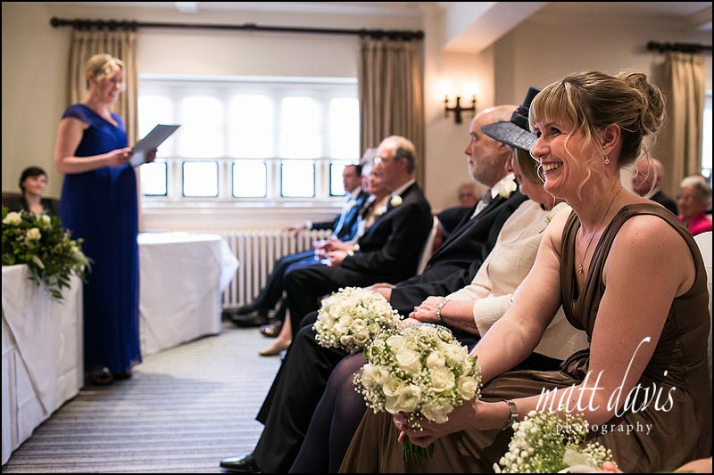 Bridesmaid laughing during wedding ceremony at Manor House Hotel
