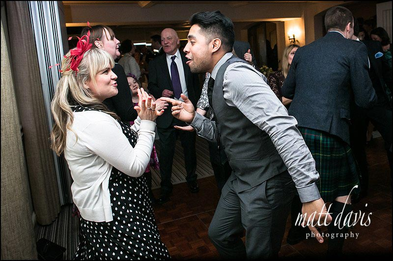 wedding photography on the dance floor at Manor House Hotel, Gloucestershire