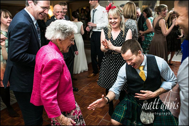 Photography on the dance floor at Manor House Hotel wedding
