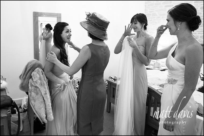Bridesmaid crying before wedding ceremony starts