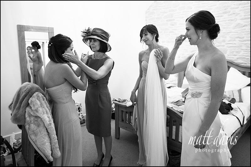 Bridesmaid crying before wedding ceremony starts at Kingscote Barn