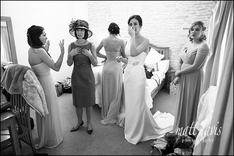 Bridesmaid crying at Kingscote Barn before wedding ceremony starts
