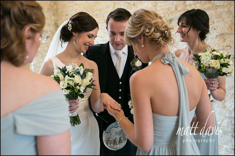 Bride shows wedding ring to bridesmaids