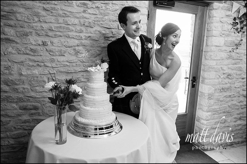cake cutting at a wedding at Kingscote Barn