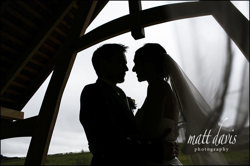 Creative wedding photos at Kingscote Barn in the winter