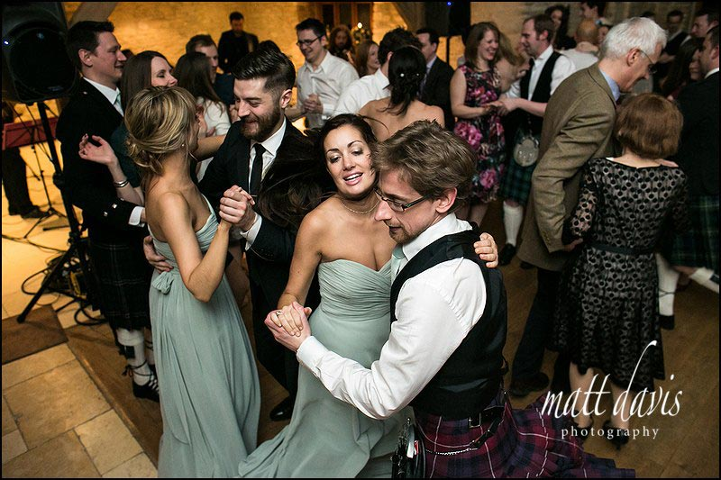 Scottish ceilidh dancing at a Kingscote Barn wedding