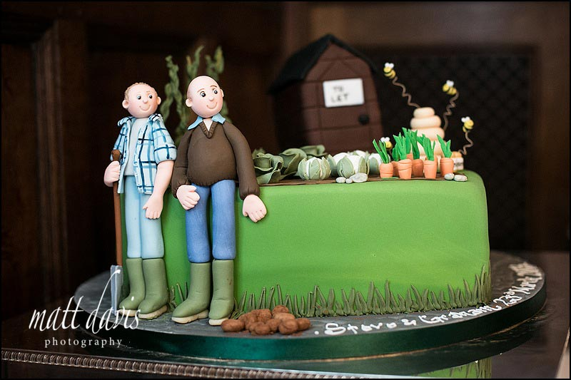 unusual wedding cake with model characters of couple