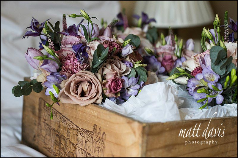 Wedding bouquet with dusky pink and purple roses and country garden flowers