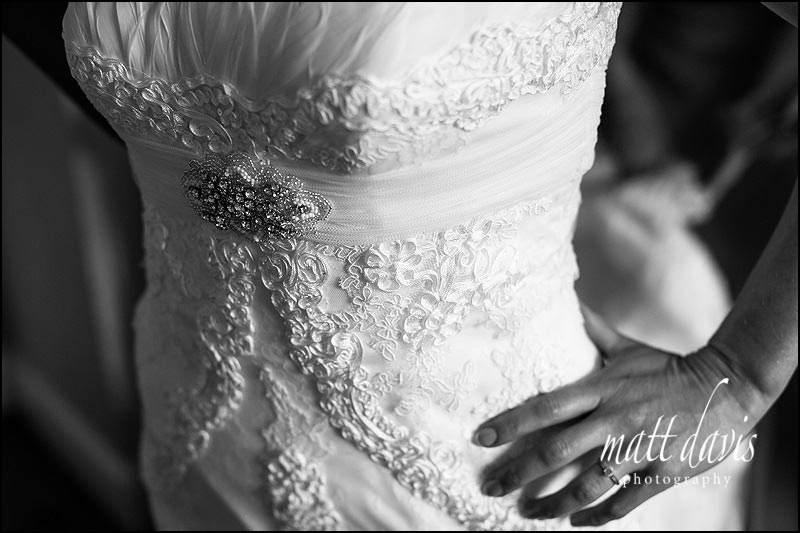 Wedding dress details with delicate feathers across the chest