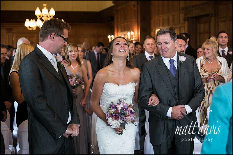 Bride with tears in eyes as she meets groom at Dumbleton Hall wedding