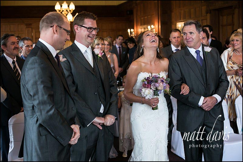 Bride and groom laughing at wedding ceremony in the Cotswolds