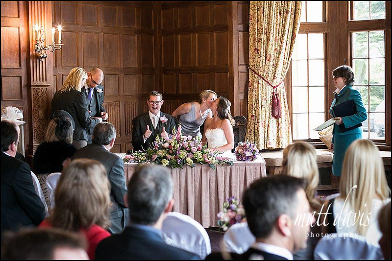 Signing of the wedding register at Dumbleton Hall