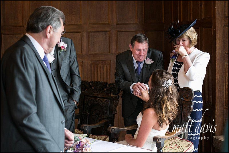 Tender moment between bride and father-in-law at their wedding at Dumbleton Hall