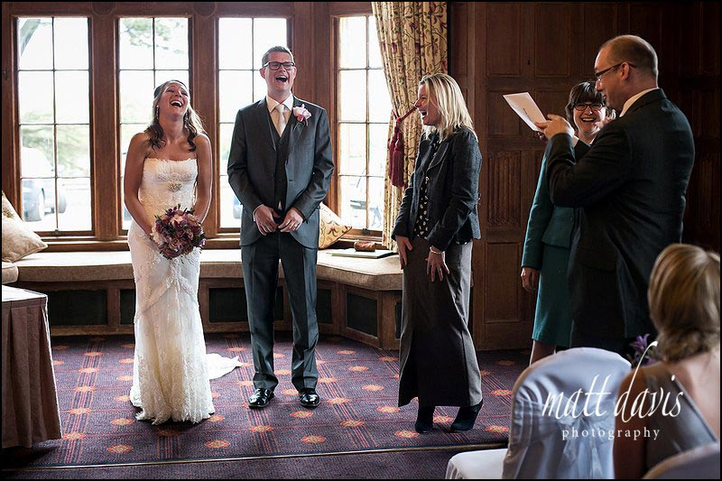 Dumbleton Hall wedding photos taken during the receiving of the marriage certificate