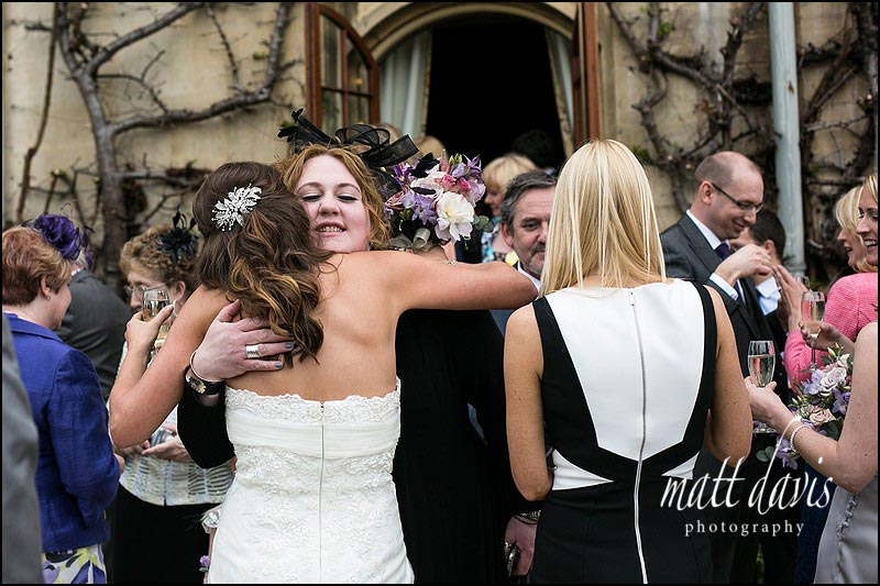 Dumbleton Hall wedding photos with guests mingling