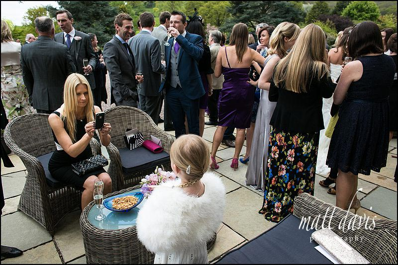 wedding photos of guests photographing each other