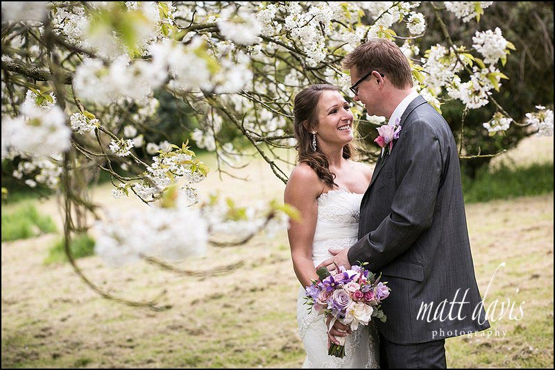 wedding photos taken at Dumbleton Hall in the tree blossom