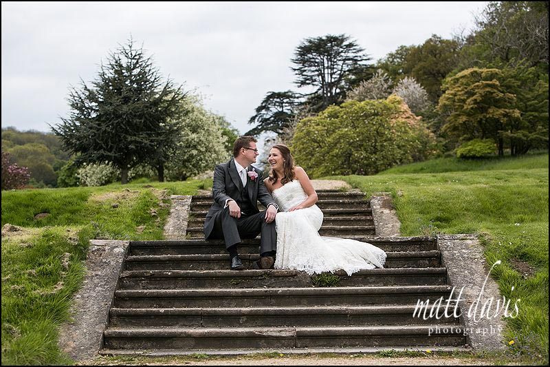 wedding photos on the steps at Dumbleton Hall