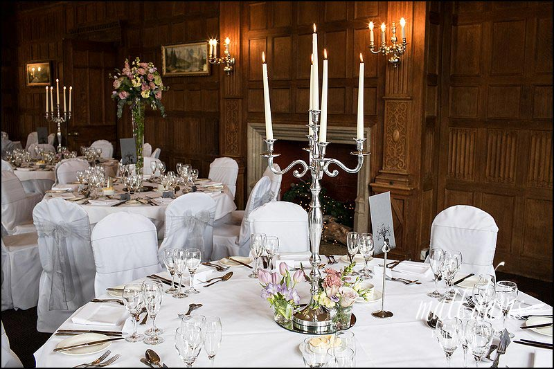 Candle arbors as table center pieces inside Dumbleton Hall