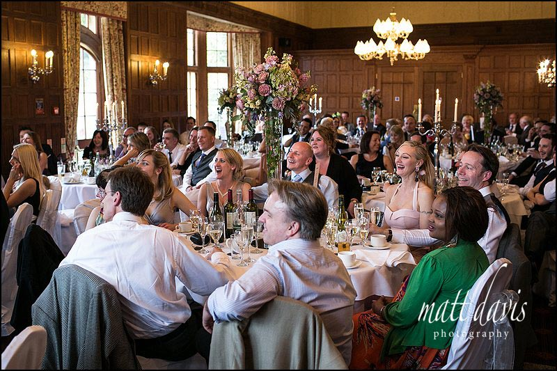 Wedding guests fill the large round tables at Dumbleton Hall wedding