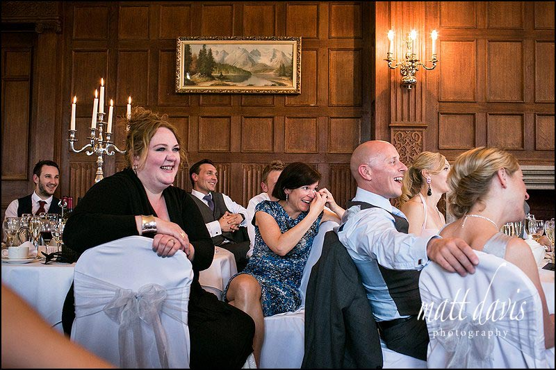 Dumbleton Hall wedding photos of guests laughing during speeches