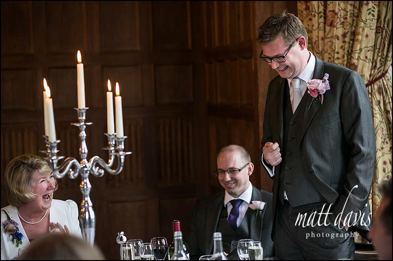 Grooms speech at Dumbleton Hall wedding, with mother laughing