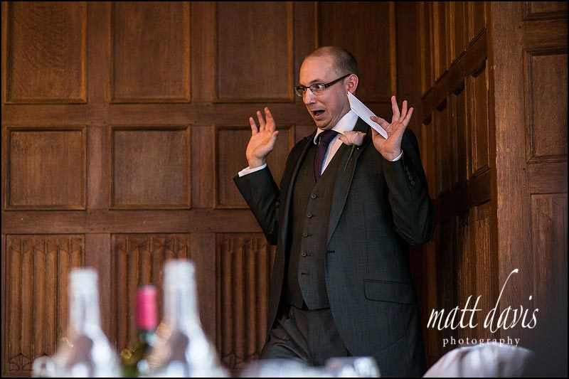wedding photo of Best man pulling a funny face during his speech