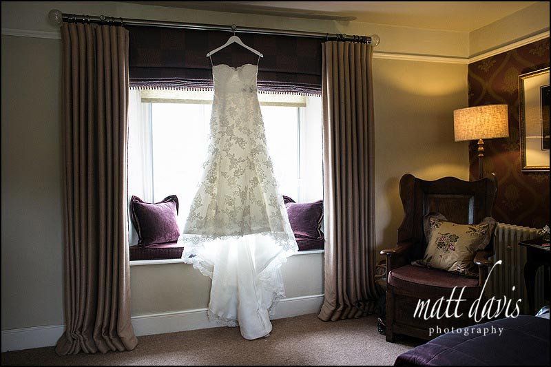 Wedding dress hung in the window of the bridal suite at Friars Court