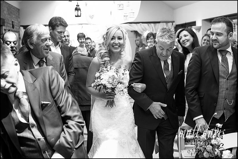 Bride walks down the aisle for her wedding at Friars Court