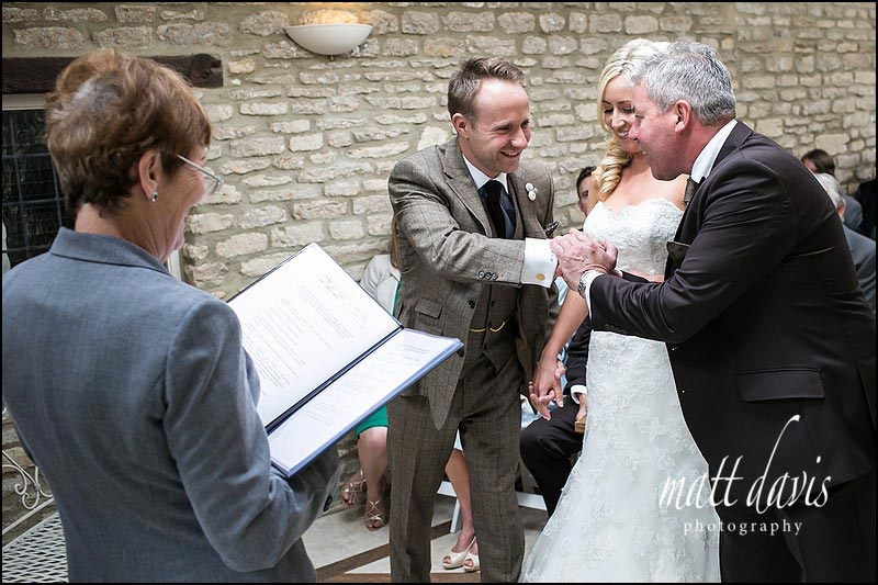 father of the bride gives her away at a wedding at Friars Court
