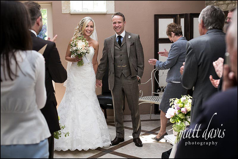 Bride and groom getting married at Friars Court inside the garden room
