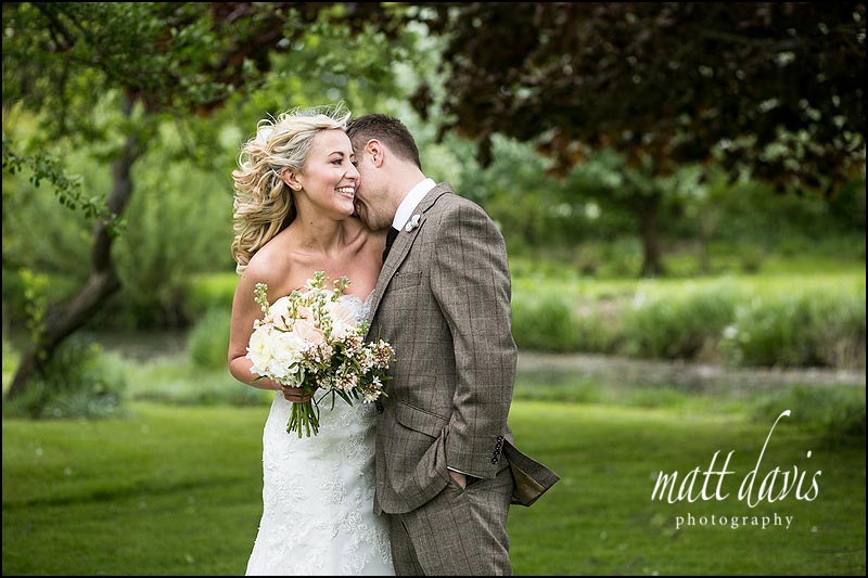 affectionate wedding photos of bride and groom