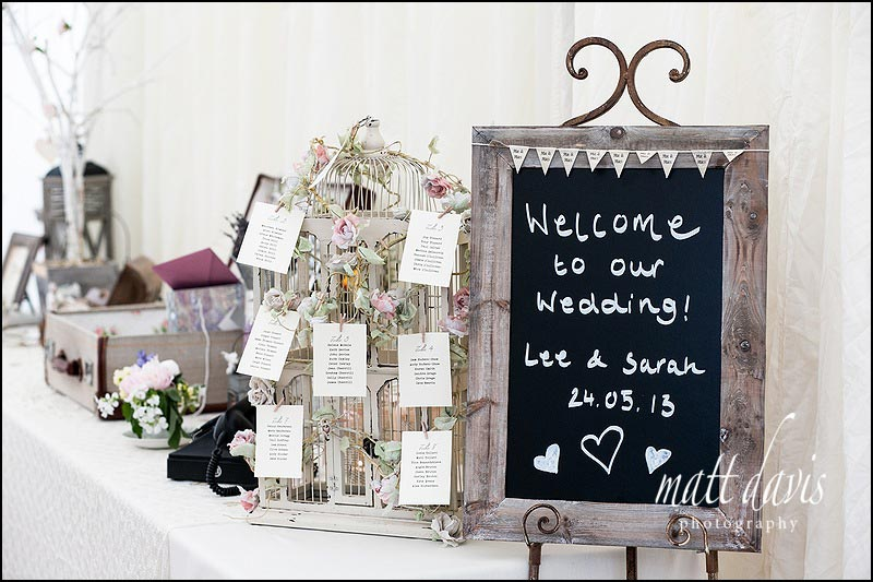 Vintage wedding details with blackboard as birdcage table plan