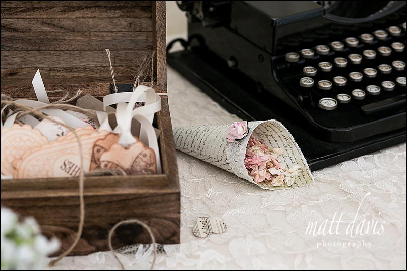 wedding details at Friars Court with vintage typewriter and confetti cones