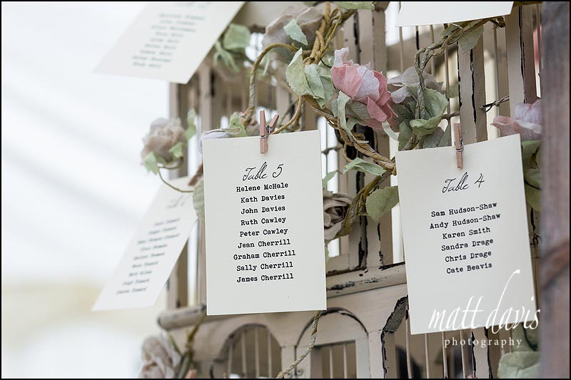 Vintage wedding details with birdcage table plan at Friars Court wedding