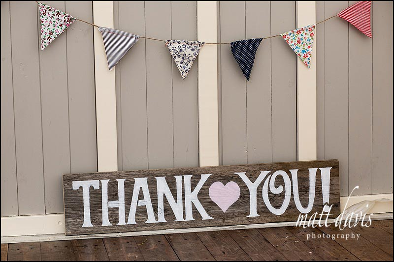 'thank you' wedding sign hand written on wood with pink heart