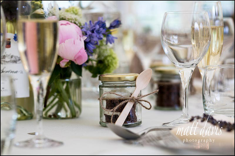 Unique wedding favours in jars with spoon attached
