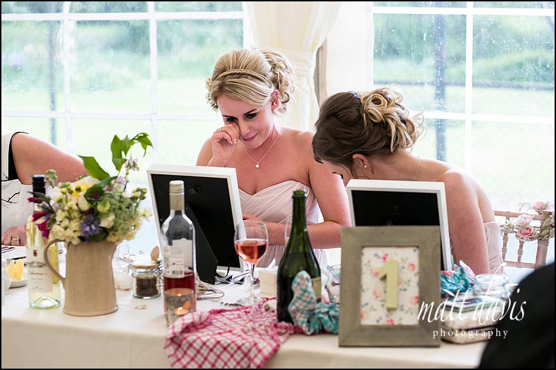 bridesmaid crying as she opens her unique wedding gift