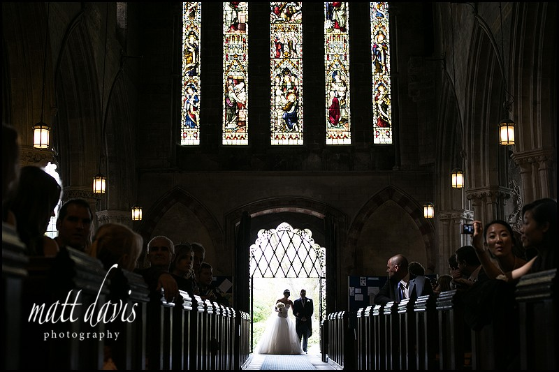 Dramatic wedding photograph of bride entering the church by Gloucestershire wedding photographer Matt Davis