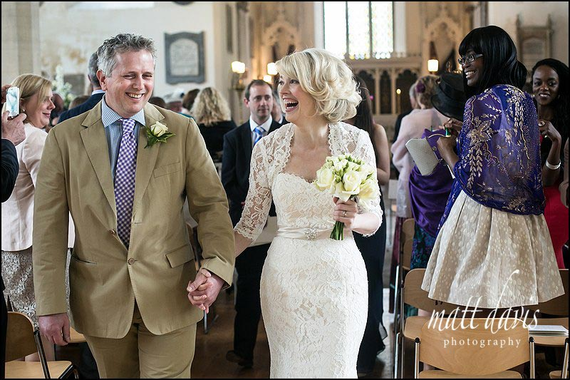 Wedding couple walking down the aisle at St Martin's Church Horsley Gloucestershire