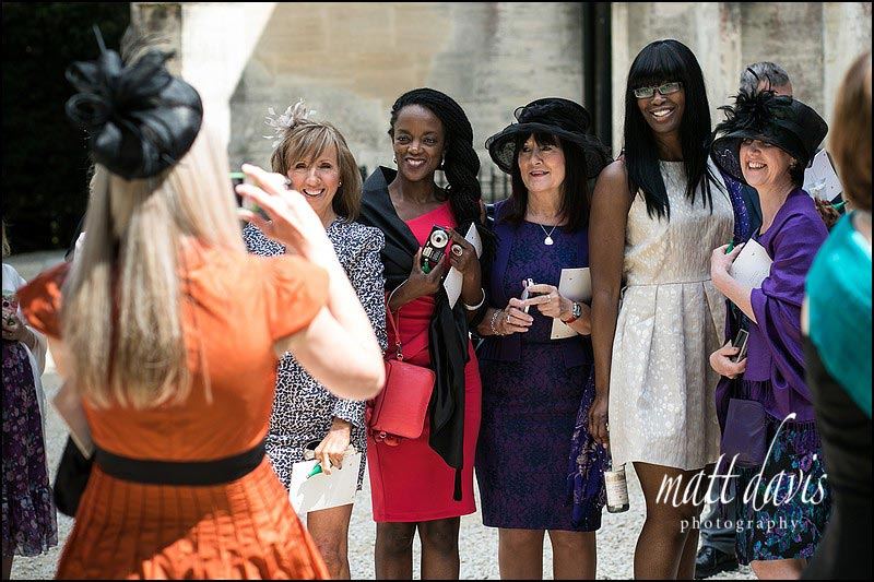 Wedding Photos of wedding guests at Horsley Church, Gloucestershire