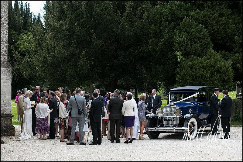 Wedding guests outside St Martin's Church, Horsley, Gloucestershire