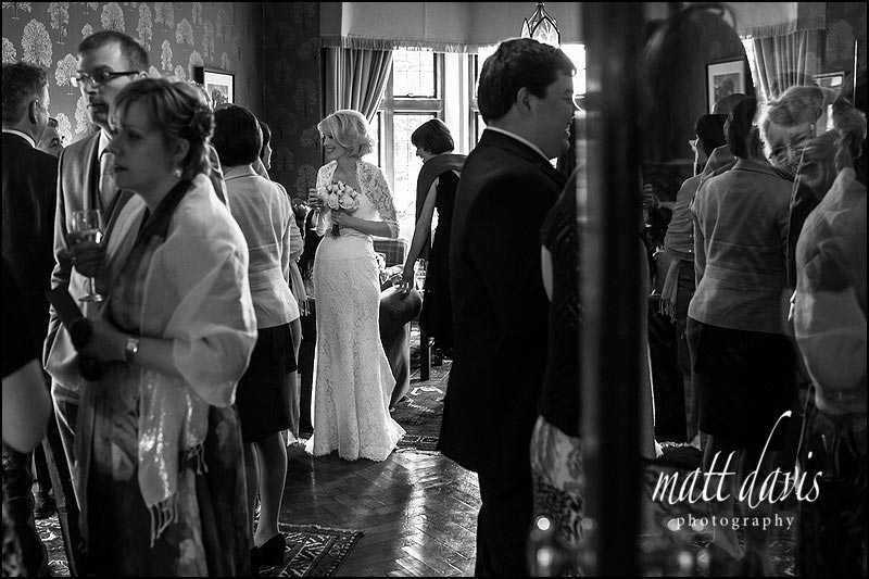 A bride enjoying her drinks reception at the Hare and Hounds, Westonbirt