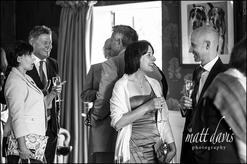 Wedding guests enjoying tthe drinks reception at the Hare and Hounds, Tetbury