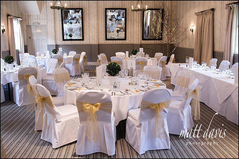 wedding photos inside the wedding breakfast room at the Hare and Hounds, Tetbury